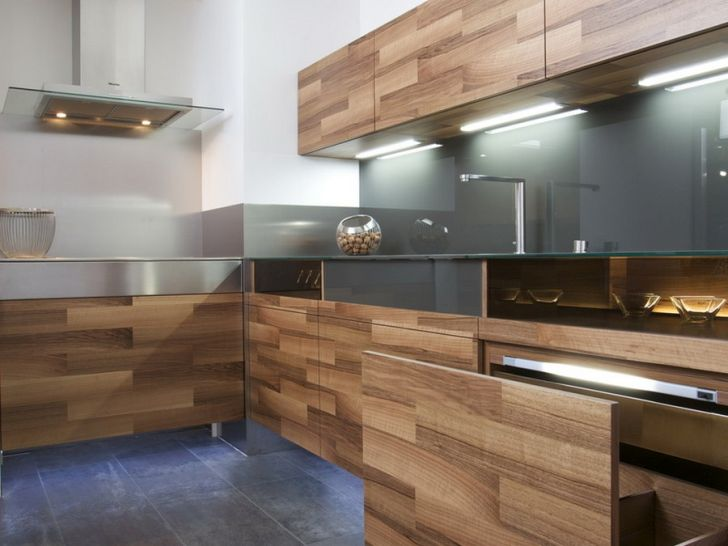 Kitchen Partes by Mateja Cukala Modern Kitchen Design with Oak Cabinet and Ceiling Lighting Under Wall Mounted Kitchen Storage