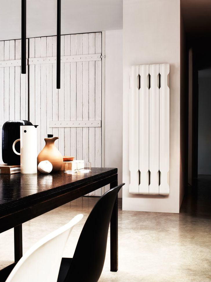 Aluminium Radiators in Agora Collection White Agora Radiator Placed in White Wall with Wooden Table