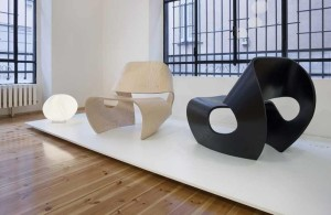 The Cowrie Chair Displays Cowrie Chair in the Laminate Woden Floor and Elegant Floor Lamp