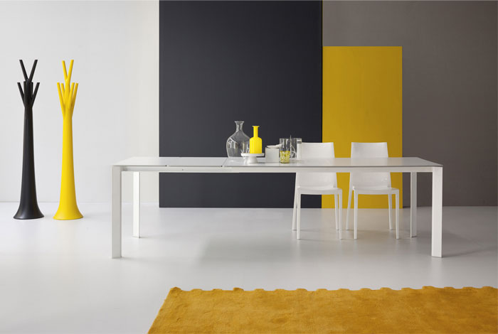 Bonaldo Table Concept White Kime Table Design and White Chairs Combines with Decorative Stuff and Yello Rugs