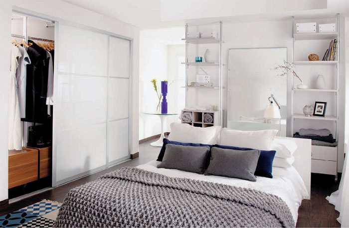 Decorate Small Bedroom White Themed Bedroom Arrangements with White Sliding Door Wardrobe and White Wooden Shelf