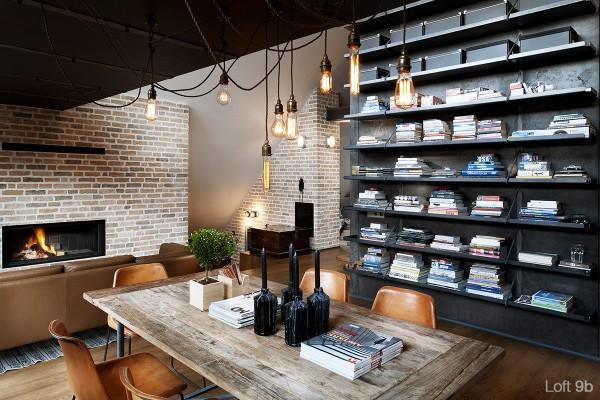 attic-apartment-with-custom-furniture-apartment-dark-bookshelf-living-room-brown-sofa-brick-fireplace-artistic-hanging-lamps