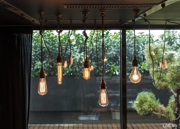 attic-apartment-with-custom-furniture-artistic-edison-bulb-design