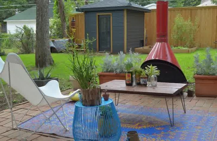 smart patio ideas backyard-patio-design-with-red-fireplace-and-blue-rug