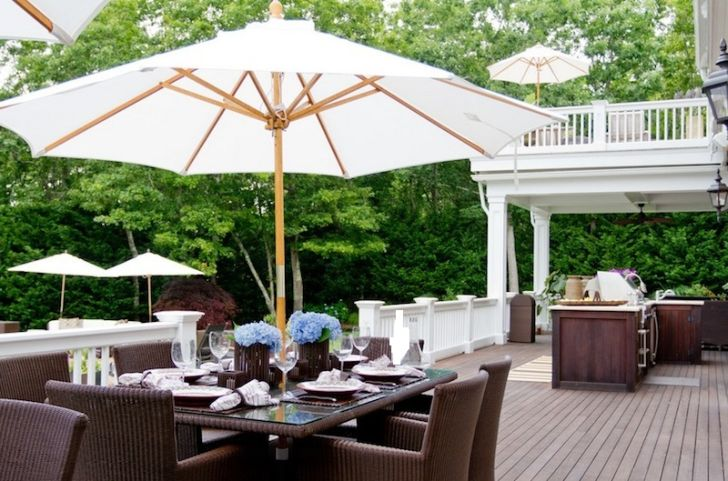 smart patio ideas dark-wood-outdoor-kitchen-with-white-garden-umbrella