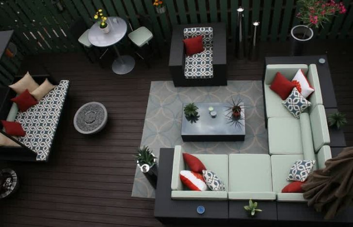smart patio ideas modern-patio-furniture-arrangement-wooden-flooring-l-shaped-sofa-light-blue-rug-red-cushions
