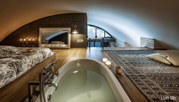 attic-apartment-with-custom-furniture-modern-second-floor-lofted-bedroom-white-bathub-large-rug