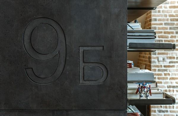 attic-apartment-with-custom-furniture-steel-book-shelving