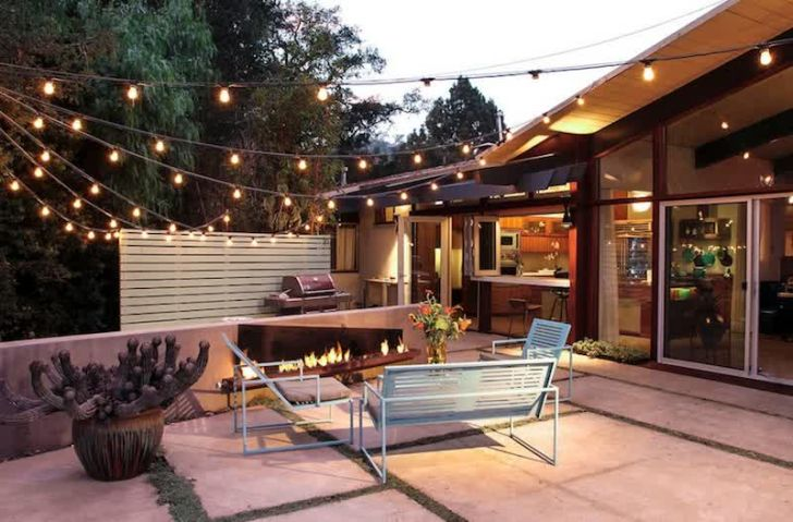 smart patio ideas warm-patio-ideas--with-fire-place-and-string-lights