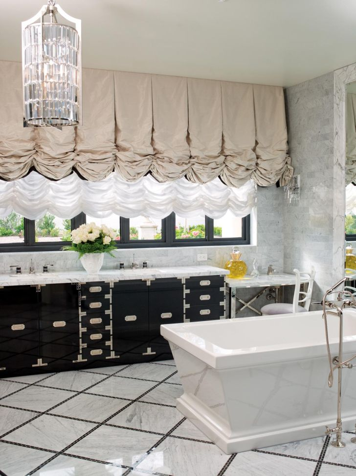 bathroom-chandelier-lighting-artistic-designed-crystal-chandelier_in-the_glass-tube_with_dark-Wooden-Vanity_and_white-bathub_also_black-framed-Window_grey-drapes
