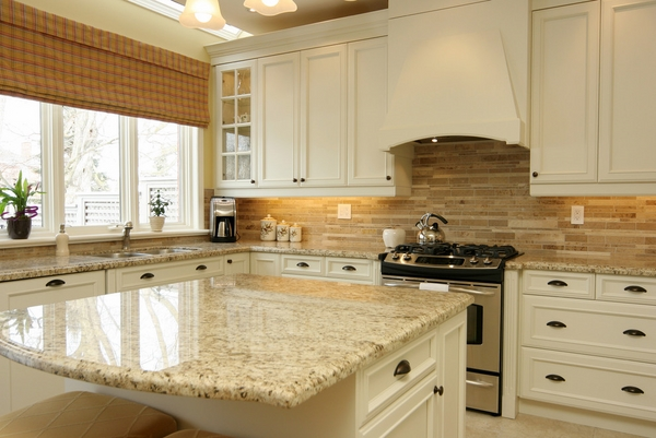 White Kitchen Theme with Giallo Ornamental Granite Countertops with Cabinet