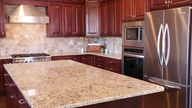Wooden Kitchen Theme with Giallo Ornamental Granite Counters