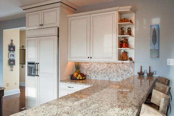 kitchen Island Design with Giallo Ornamental Granite Countertop and White Cabinets