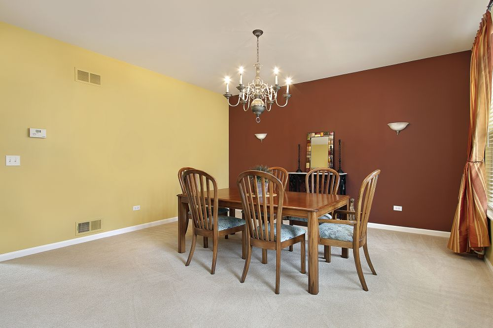 calm dining room with smart mix of color tone and nice contrast of the walls