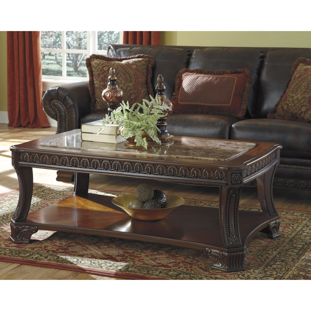 contemporary living room with bold carved wooden norcastle coffee table and glossy top