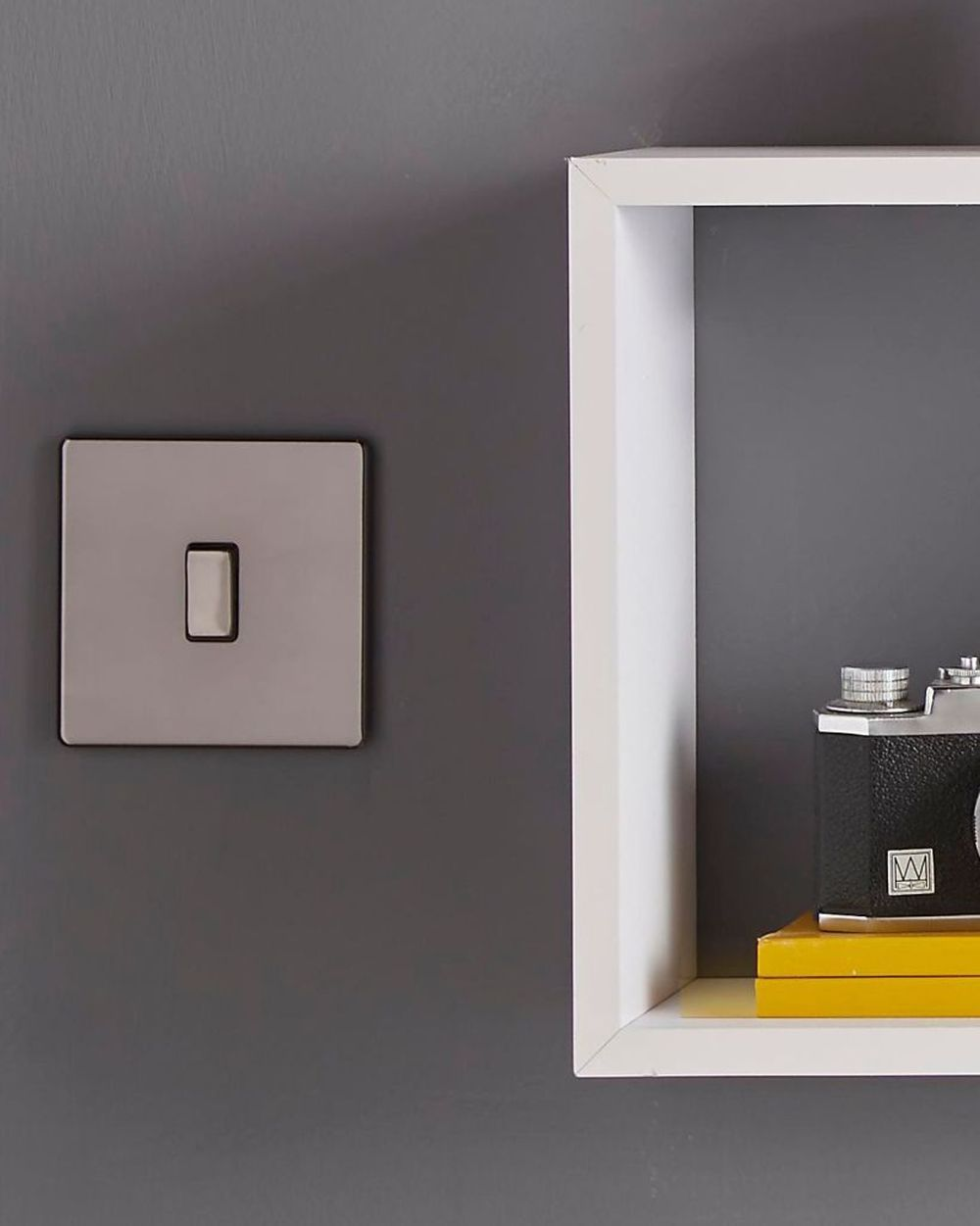elegant modern mobile home style with grey light switch with white cubical shelving unit on wall