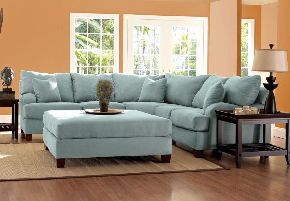 light blue microfiber couch design with wall orange paint and contrast wooden end tables