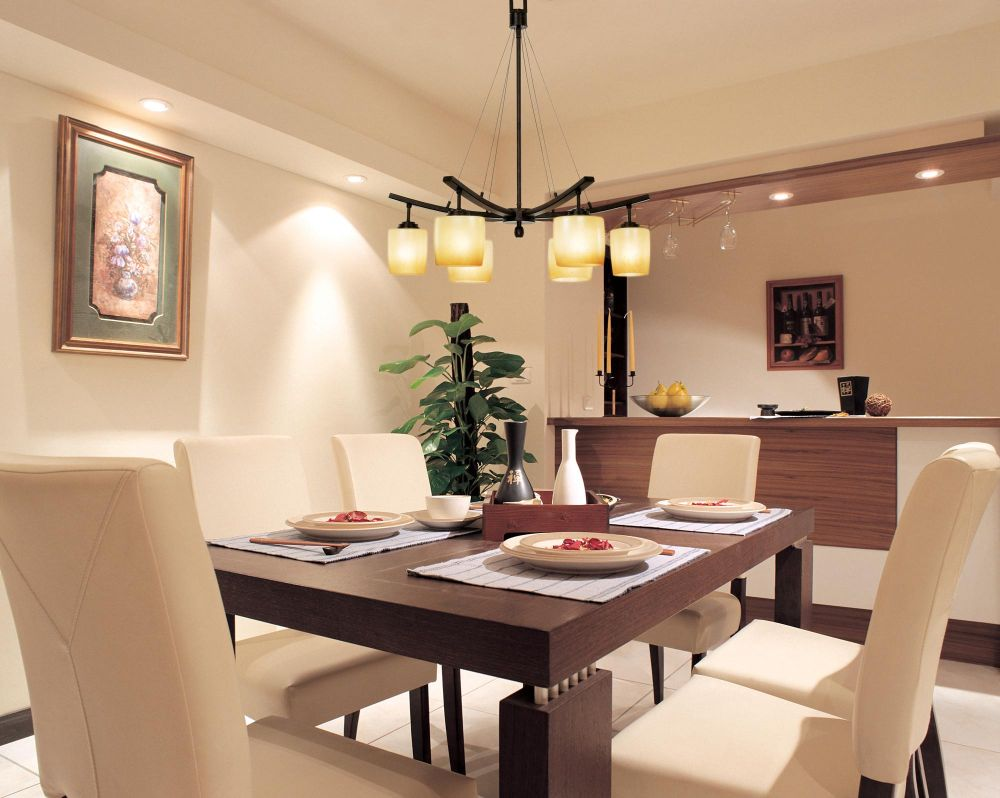 modern hanging light for dining room with wooden table and chairs
