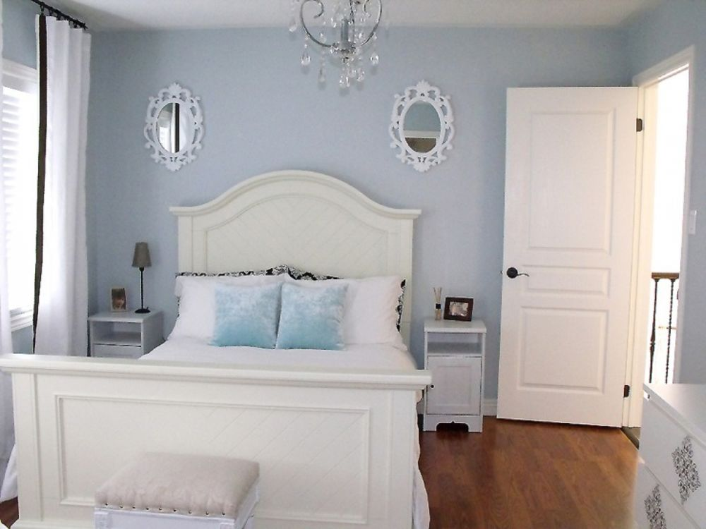 space saving white bedroom design with stylish gray shade wall and white pine bedframe