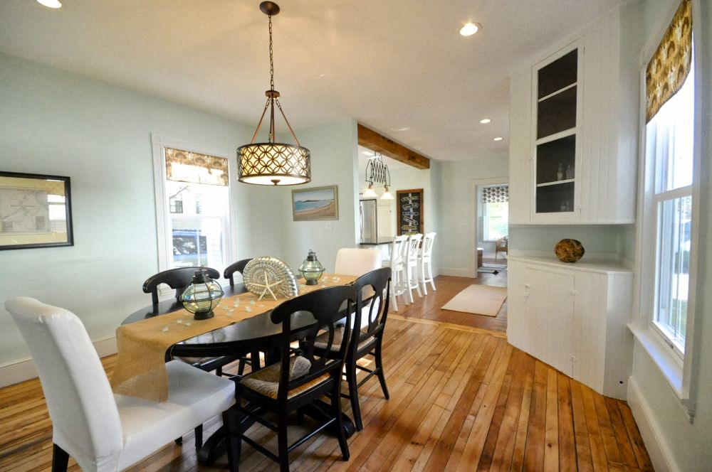 vintage dining room ideas with hanging round lighting design and wooden flooring