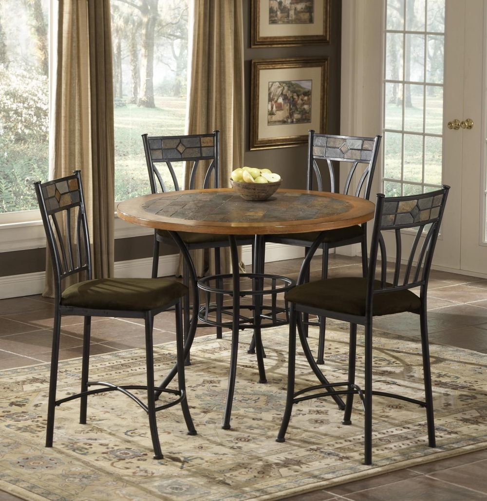 wooden dining table with wrough iron frame and art deco padded chairs
