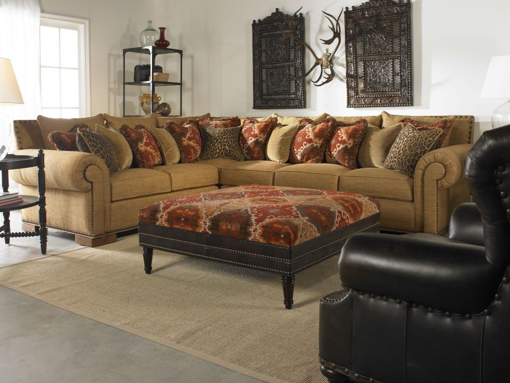 l-shaped brown sofa with floral pattern pillow and atistic wall decoration remarkable sectional sofas inducing elegance and warmth in houston homes