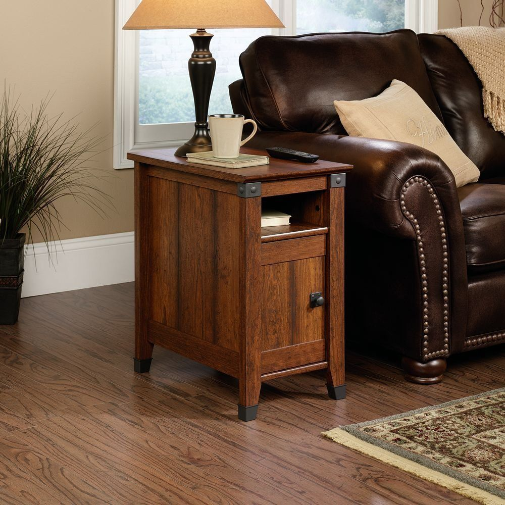 living room with wooden side table and leather sofa plus small storage aith a wooden door outstanding side table to beautify living room