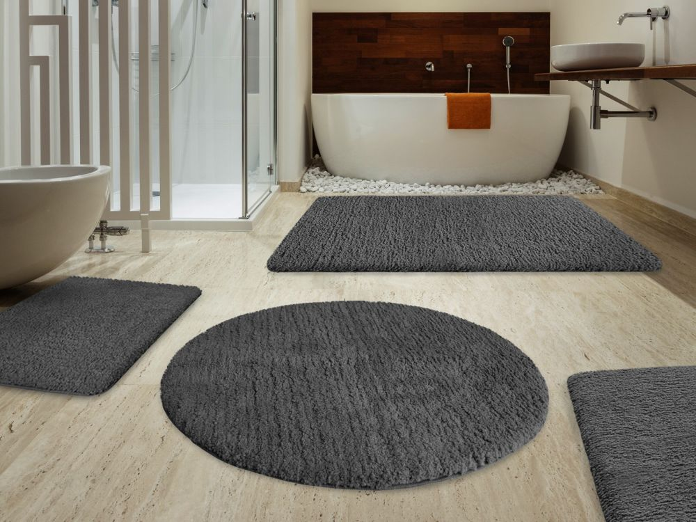 round grey rug on the light brown laminate floor round bathroom rugs