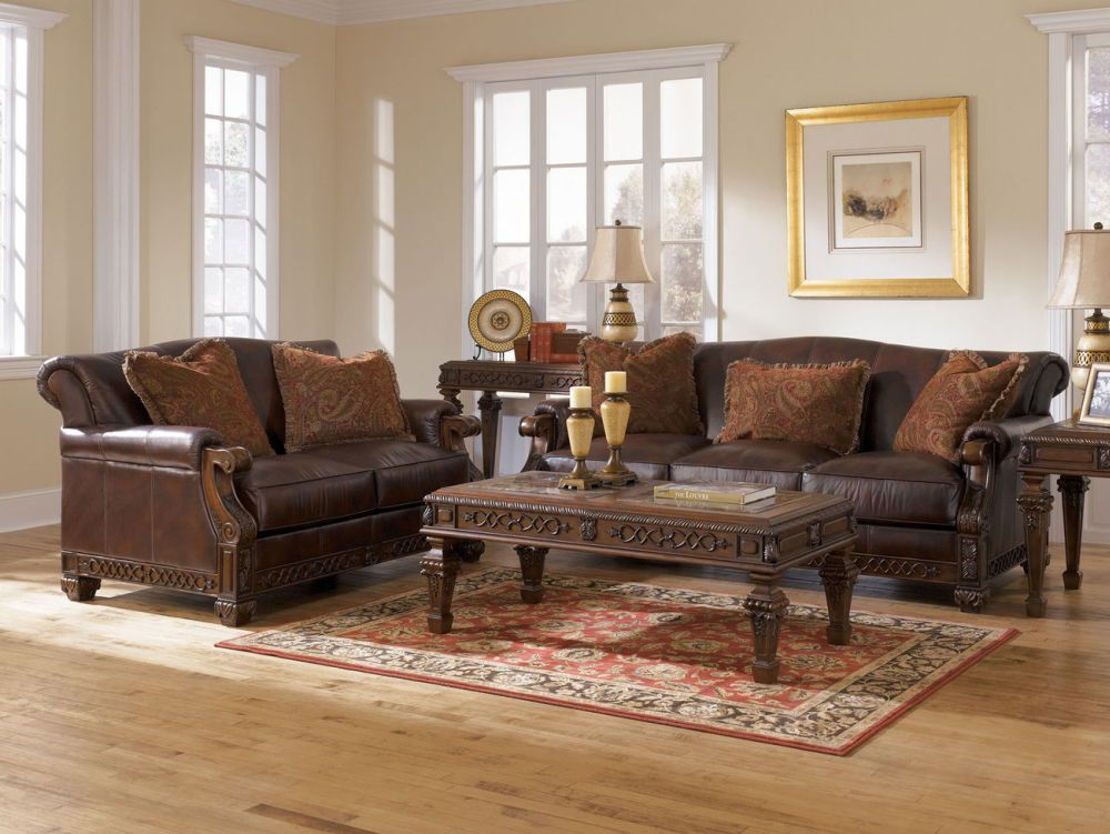 dark brown sofas from the distressed leather with the snazzy retro pattern cushions and the carved solid wood frame durable snazzy distressed leather sofa coming with humble outlook