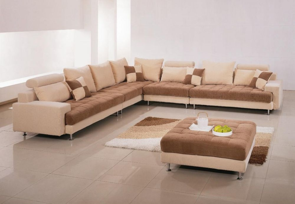 luxurious long creamy sofa design with gradation effect added on the surface presenting best interior design with extra long sofa