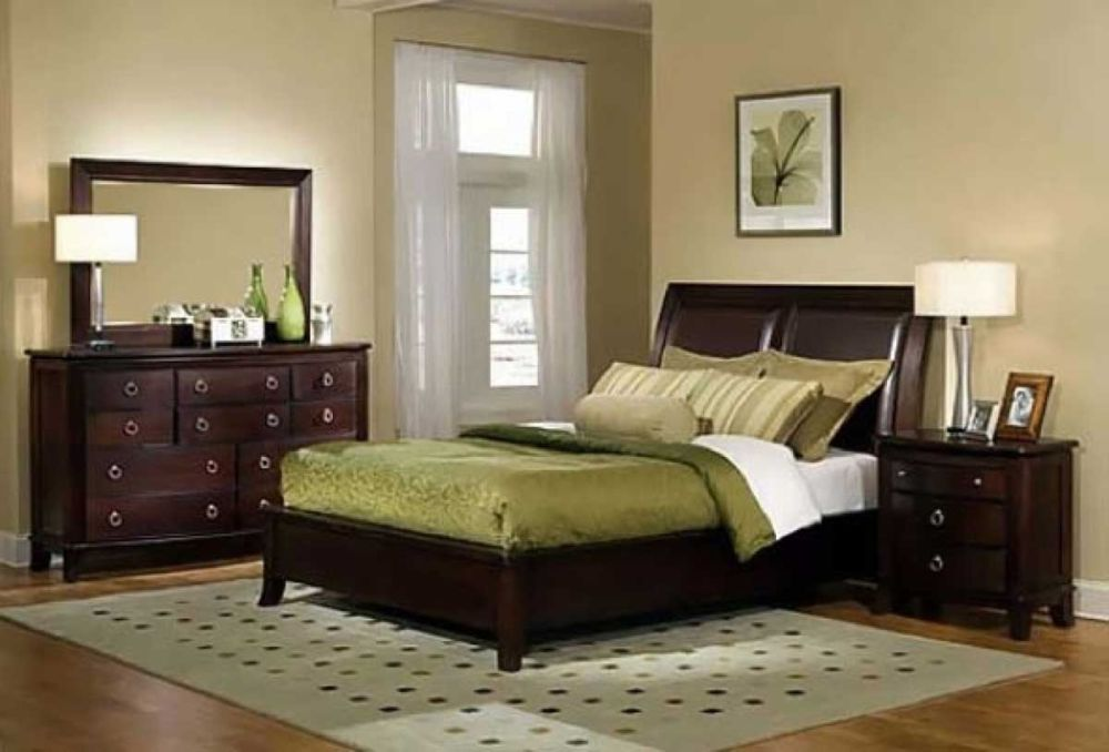 spacious bedroom space is painted with soft beige color scheme and rustic modern dark solid wood furniture sets discovering the answer of what color should i paint my bedroom easily