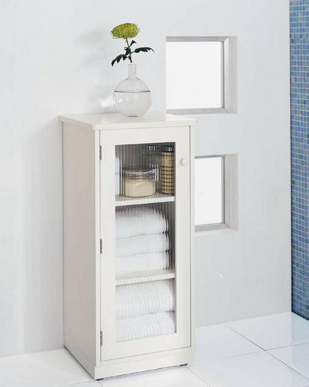 simpler linen tower design in pure white color with the glass accent applied on the door bathroom linen tower – space saver storage idea