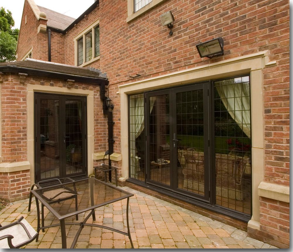 brown brick house with french windows and doors chic window jamb designs giving the perfect atmosphere
