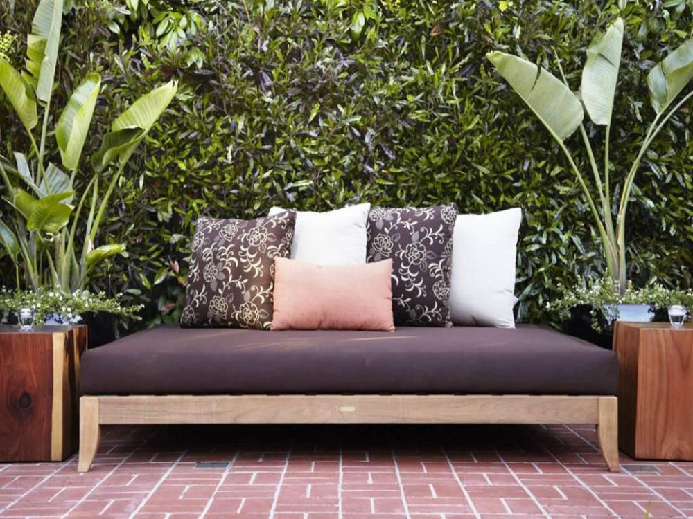 black-outdoor-daybed-mattress-with-floral-pillow-outdoor-daybed-cushion-buying-guide