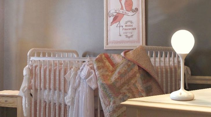 The Drop Light Drop Light in the Nursery Room with White Wooden Baby Cribs Soft Blanket