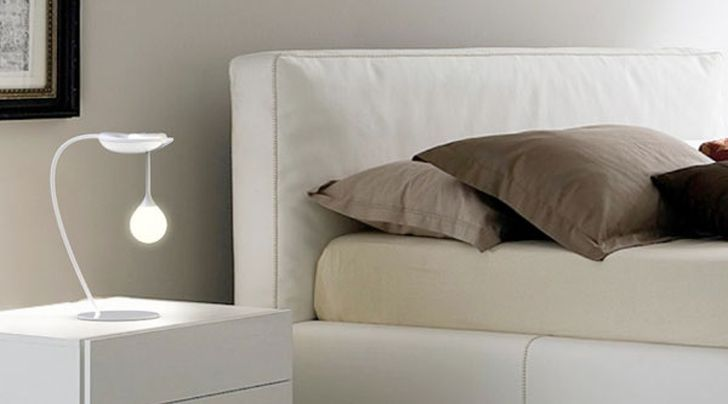 The Drop Light Drop Light on the White Nightstand in the Comfortable Bedroom with Brown Pillow