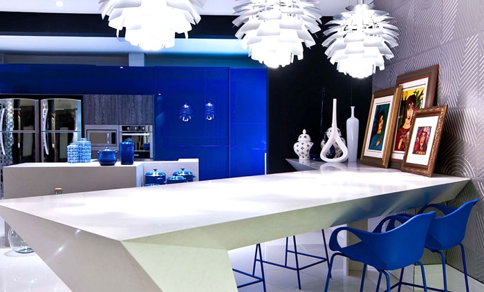 kitchen countertop sland White Kitchen Island Countertop with elegant white pendant lamps and blue cabinet