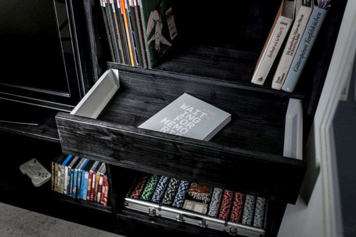 multifunctional furniture for small spaces-black-book-storage-room-living-cube-by-till-konneker