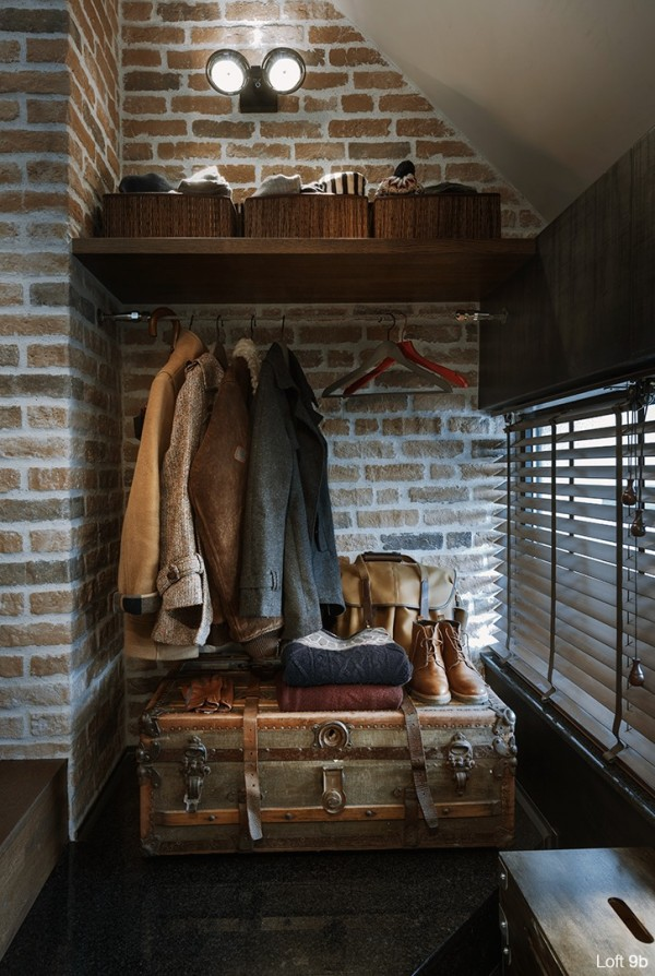 attic-apartment-with-custom-furniture-modern-coat-closet-classic-suitcase