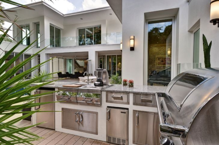 outdoor kitchen design-outdoor-kitchen-stainless-cabinets-marble-countertop