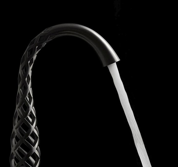 3d-printed-faucet-spiral-3D-faucets-design-from-DVX-by-American-Standard-with-stream-bouncing-on-rocks-in-a-riverbed
