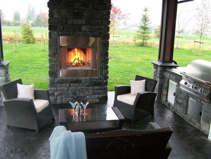smart patio ideas stone-patio-design-with-wicker-furniture-and-gray-stone-fireplace