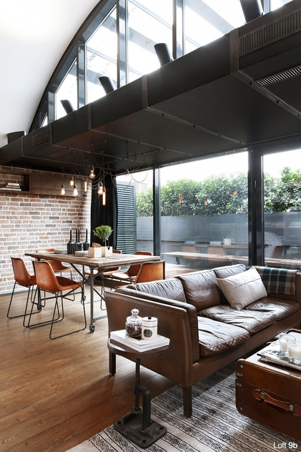 attic-apartment-with-custom-furniture-unique-apartment-with-modern-leather-sofa-black-framed-glass-wall-wooden-dining-table