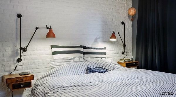 attic-apartment-with-custom-furniture-white-brick-bedroom-wall-artistic-wall-lamps