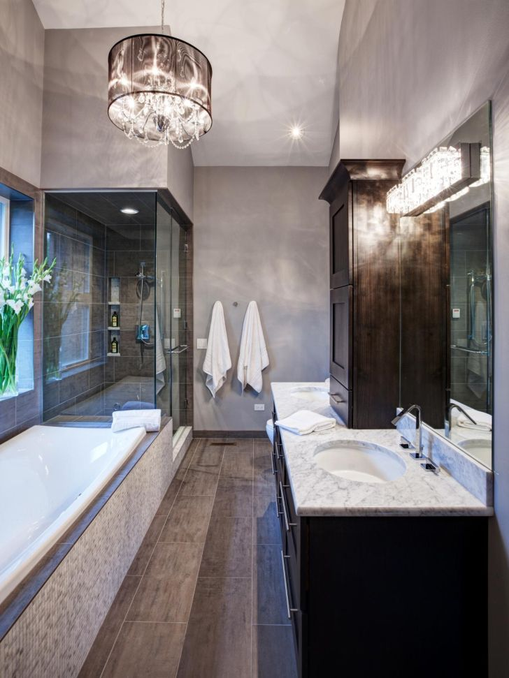 bathroom-chandelier-lighting-bathroom-design_with_crystal-chandeliers_and_glass-wall-shower_dark-Wooden-Storage_marble-countertop_large-square-mirror