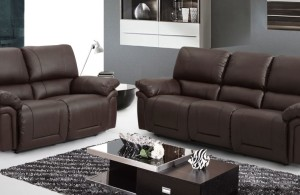 dark leather sofa with wooden coffee table and soft rug