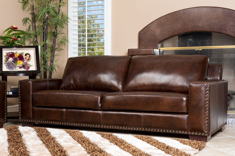 elegant brown leather sofa with wide rug and fireplace excellent leather sofas on sale