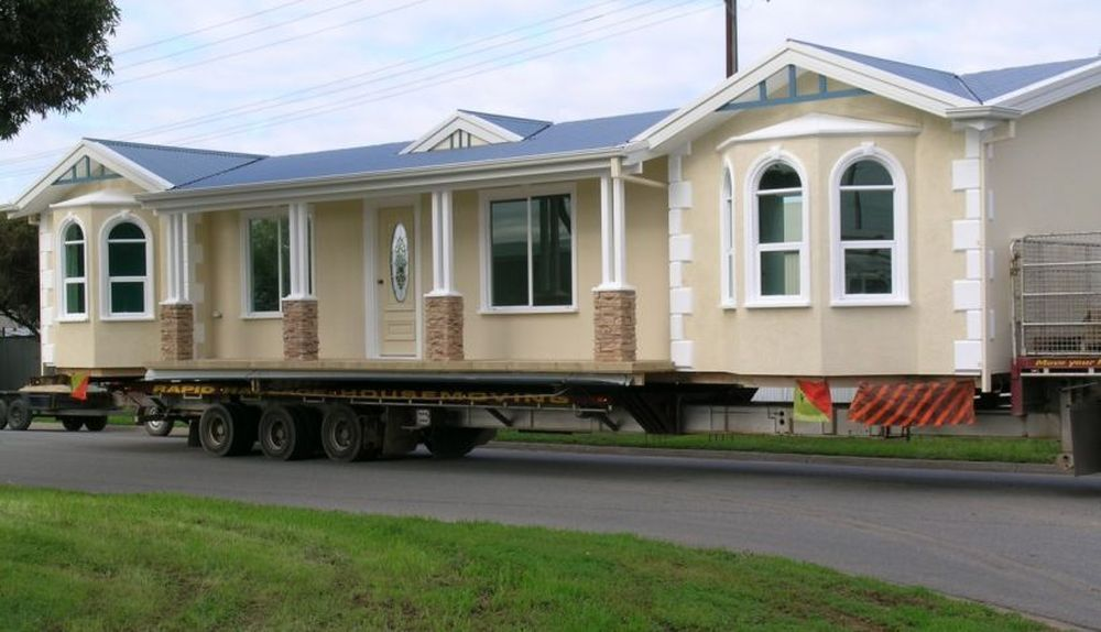 awesome traditional style mobile home with truck wheels and navy blue vaulted roof plus apacious terrace
