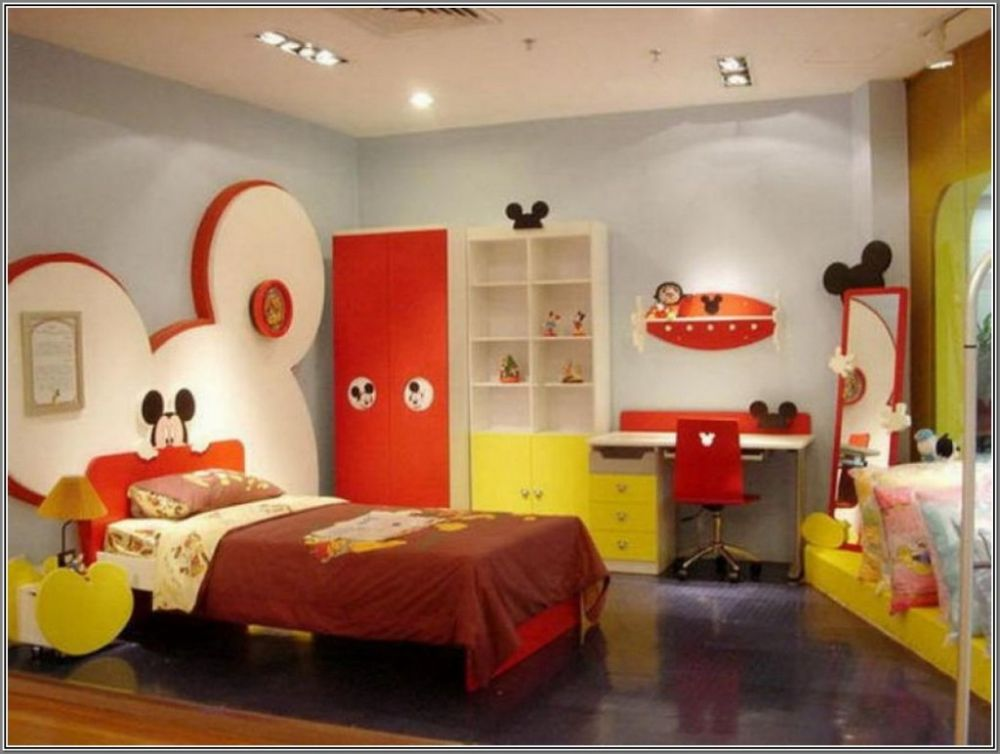cheerful Mickey mouse bedroom design with Mickey headboard and colorfull wooden closet