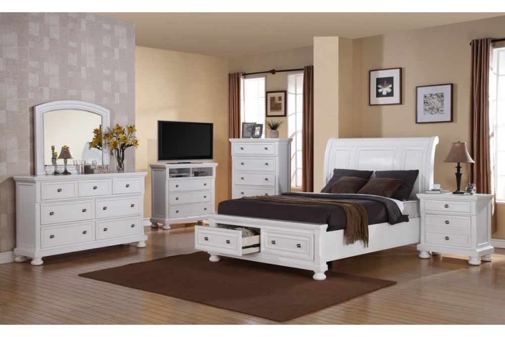 classic white queen bedroom furniture set with two under bed drawers and white vanity with a mirror